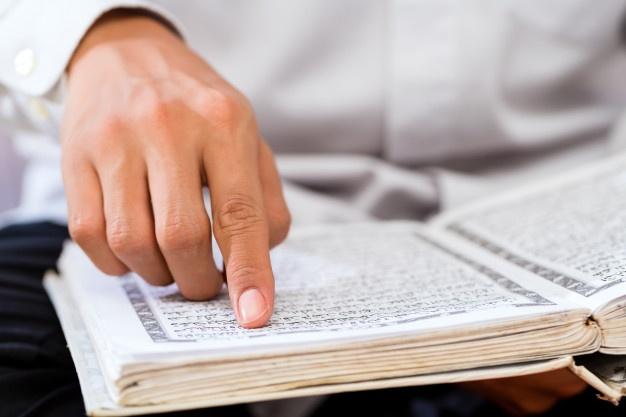 asian-muslim-man-studying-koran-quran_79405-1796